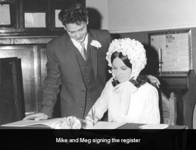 Mike and Meg signing the register